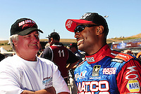 Jul. 18, 2010; Sonoma, CA, USA; NHRA top fuel dragster driver Steven Chrisman (left) talks with Antron Brown during the Fram Autolite Nationals at Infineon Raceway. Mandatory Credit: Mark J. Rebilas-