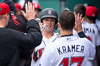 Indianapolis Indians right fielder Eric Wood (14) celebrates with teammates after hitting a home run after hitting a home run during an International League game against the Columbus Clippers on April 30, 2019 at Victory Field in Indianapolis, Indiana. Columbus defeated Indianapolis 7-6. (Zachary Lucy/Four Seam Images)