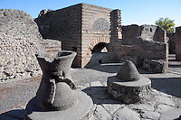 House of the Baker, Pompeii, built 2nd century BC, and remodelled after the 62 AD earthquake. The two millstones are made of lava rock and placed on an opus incertum base