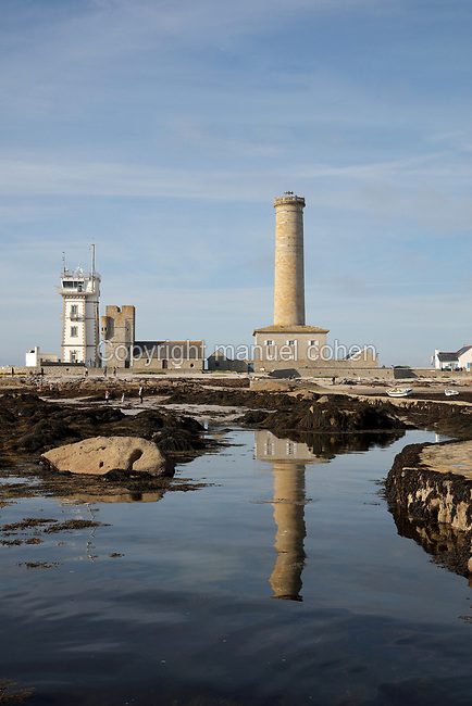 Left-right, the Semaphore, built 1862, the Vieille Tour or Old Tower, part of the Chapelle Saint-Pierre, where fires were lit to warn ships, and the Phare de Penmarc'h, commissioned 1835 at 40m high, seen from the breakwater at Saint-Pierre on the Pointe de Penmarc'h, Finistere, Brittany, France. Three small fishing ports developed in this area, but despite the building of a breakwater, sea access remained perilous. Picture by Manuel Cohen