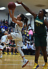 Mariah Benavides #1 of Baldwin, left, drives to the net for two points against Longwood during the Chanee Monique Brown Memorial Tournament at Baldwin High School on Friday, Dec. 28, 2018. Baldwin won by a score of 56-47.