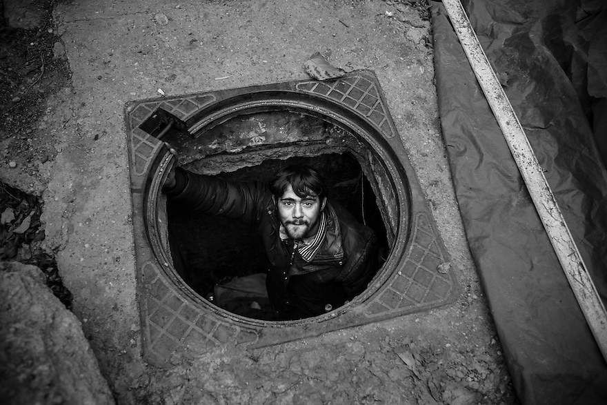 "Remus, 26, sleeps alone in an underground space. His ""home"" is at Piata Victoriei, an important square in the center of Bucharest."