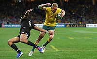Reece Hodge of the Wallabies breaks past Rieko Ioane of the All Blacks to score a try during the Rugby Championship match between Australia and New Zealand at Optus Stadium in Perth, Australia on August 10, 2019 . Photo: Gary Day / Frozen In Motion