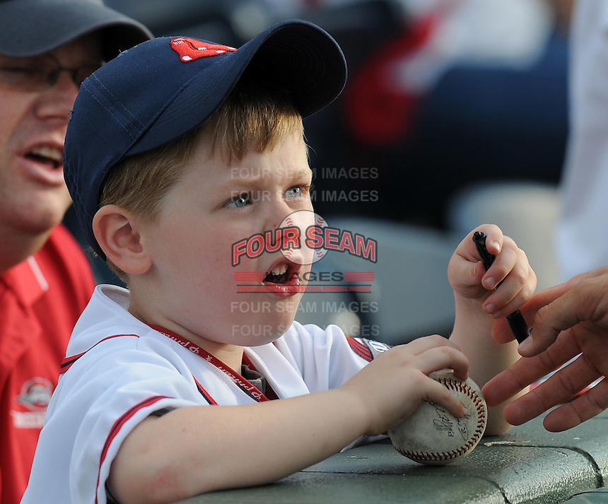 April 30, 2009: A young boy gets a player's autograph on his baseball prior to a Greenville Drive game at Fluor Field at the West End in Greenville, S.C. Photo by: Tom Priddy/Four Seam Images