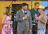 NEW YORK, NY - JULY 8: Ginger Zee and Jesse Palmer interview Kenny Chesney on ABC's 'Good Morning America' at SummerStage at Rumsey Playfield, Central Park on July 8, 2016 in New York City. Credit: John Palmer / MediaPunch