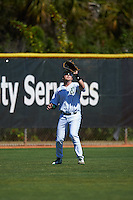 Eastern Michigan Eagles left fielder John Montgomery (44) catches a fly ball during a game against the Dartmouth Big Green on February 25, 2017 at North Charlotte Regional Park in Port Charlotte, Florida.  Dartmouth defeated Eastern Michigan 8-4.  (Mike Janes/Four Seam Images)