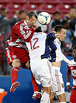 FC Dallas midfielder Andrew Jacobson (4) and Real Salt Lake midfielder Cole Grossman (12) in action during the game between the FC Dallas and the Real Salt Lake at the FC Dallas Stadium in Frisco,Texas...