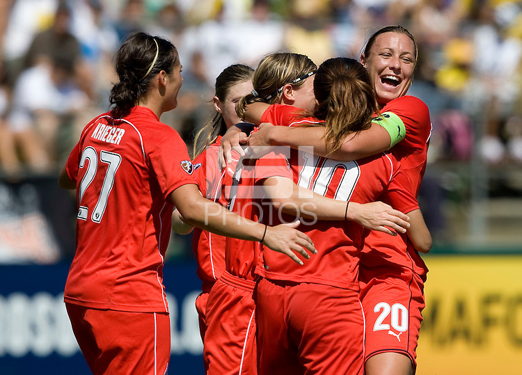 01 August 2009:  Abby Wambach of the Freedom celebrates with teammates after Sawa scored a goal during the second half of the game against FC Gold Pride at Buck Shaw Stadium in Santa Clara, California.   FC Gold Pride defeated Washington Freedom, 3-2.