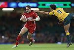Wales replacement Cory Allen steps inside Australian scrum half Nick Phipps.<br /> Dove Men Series 2014<br /> Wales v Australia<br /> Millennium Stadium<br /> 08.11.14<br /> ©Steve Pope-SPORTINGWALES