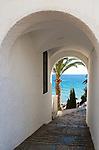 Alleyway blue Mediterranean Sea  holiday resort town of Nerja, Malaga province, Spain