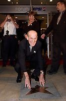 September 26. 2002, Montreal, Quebec, Canada; <br /> <br /> Celine Dion father pose with Celine's Bronze Star at the Pepsi Forum's Walk of Fame, September 26 2002, Montreal, CANADA.
