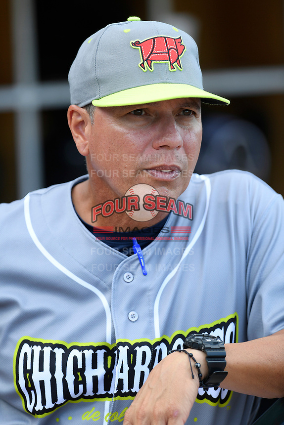 Manager Pedro Lopez (16) of the Columbia Fireflies, playing as the Chicharrones de Columbia, in a game against the Charleston RiverDogs on Friday, July 12, 2019 at Segra Park in Columbia, South Carolina. The RiverDogs won, 4-3, in 10 innings. (Tom Priddy/Four Seam Images)