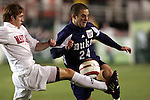 11 November 2005: Maryland's Spencer Allen (left) plays the ball off Duke's Danny Kramer (right). Duke University defeated the University of Maryland 4-2 at SAS Stadium in Cary, North Carolina in a semifinal of the 2005 ACC Men's Soccer Championship.