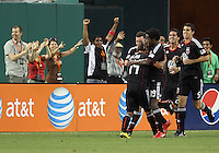 Fans and teammates congratulate Andy Najar #14 of D.C. United after he scored during an MLS match against the Los Angeles Galaxy at RFK Stadium on July 18 2010, in Washington D.C. Galaxy won 2-1.