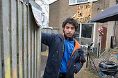 Abdou Guernaoui (aged 14) at a house occupied by housing campaigners on the Sweets Way estate in Whetstone, Barnet, London.  His family was evicted from their former home on the estate and placed in emergency accommodation outside the borough in February. Abdou now has to travel up to 2 hours each way to school and evening football practice sessions.  The evictions took place in advance of proposed demolition and redevelopment by Annington, a subsidiary of private equity investors Terra Firma.