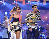 SUNRISE FL - DECEMBER 18: Jin Joo Lee and Joe Jonas of DNCE perform at the Y100 Jingle Ball 2015 held at The BB&T Center on December 18, 2015 in Sunrise, Florida. (Photo by Larry Marano © 2015