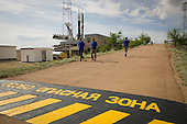 """The Soyuz TMA-04M spacecraft is seen in the background, as markings on the road leading up to the launch pad cautions visitors and workers that they are entering the """"extreme danger zone"""" at the Baikonur Cosmodrome, Sunday, May 13, 2012 in Kazakhstan.  The launch of the Soyuz spacecraft with Expedition 31 Soyuz Commander Gennady Padalka and Flight Engineer Sergei Revin of Russia, and prime NASA Flight Engineer Joe Acaba is scheduled for 9:01 a.m. local time on Tuesday, May 15, 2012..Mandatory Credit: Bill Ingalls / NASA via CNP"""