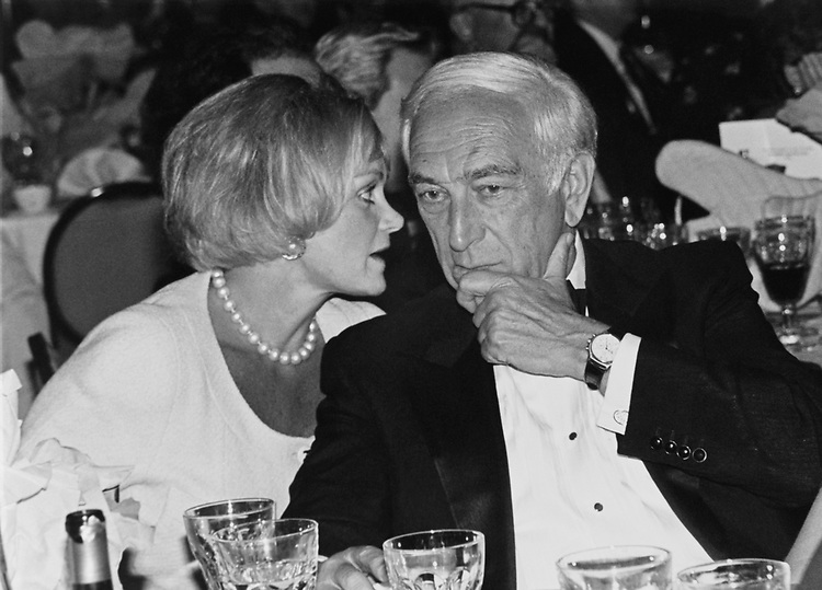 Here American journalist Kitty Kelley whispering to Sen. Frank Lautenberg, D-N.J., at Independent Action's Roast of Governer Ann Richards. They definetely were enjoying the evening, in 1991. (Photo by Maureen Keating/CQ Roll Call via Getty Images)