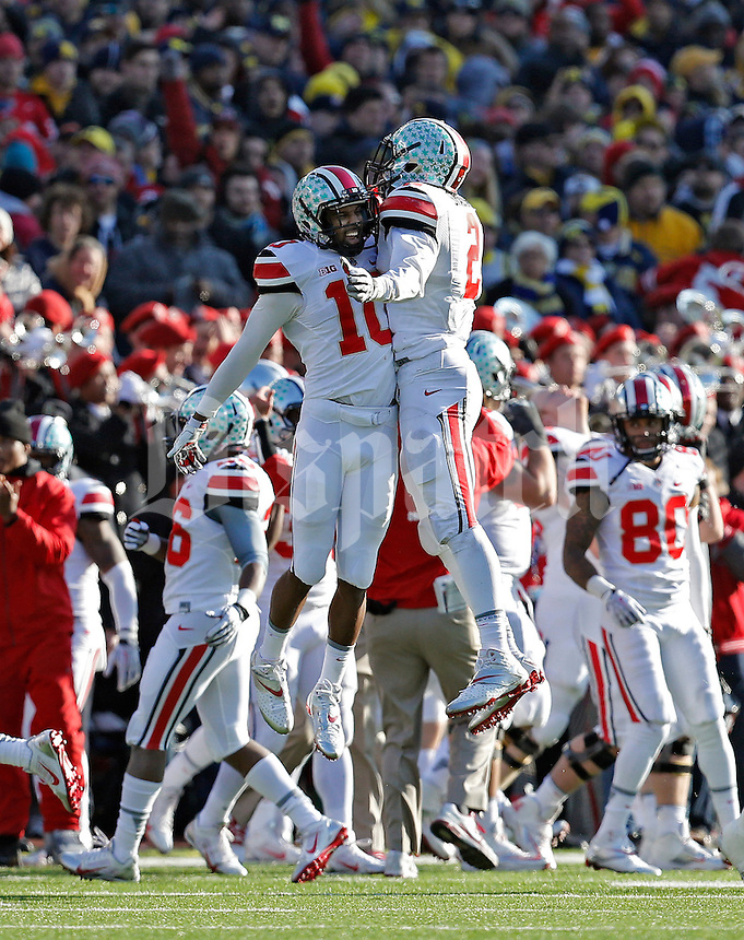 Ohio State Buckeyes line backer Ryan Shazier (2) celebrates with Ohio State Buckeyes wide receiver Philly Brown (10) after the Michigan Wolverines lost a fumble in the 3rd quarter of their college football game at Michigan Stadium in Ann Arbor, Michigan on November 30, 2013.  (Dispatch photo by Kyle Robertson)