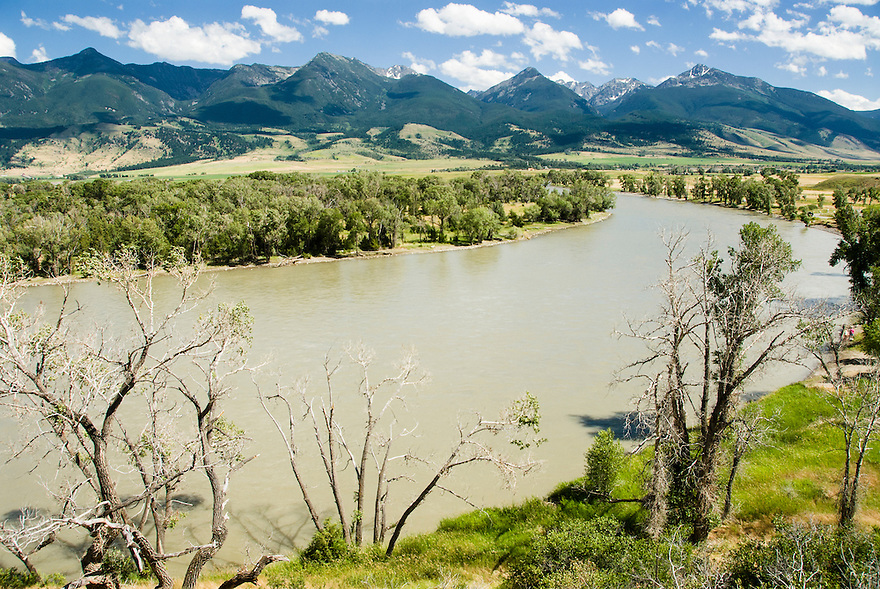 The Yellowstone River flows during high water beneath the peaks of the Absaroka Mountains