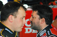 May 1, 2009; Richmond, VA, USA; NASCAR Sprint Cup Series driver Tony Stewart (right) with teammate Ryan Newman during practice for the Russ Friedman 400 at the Richmond International Raceway. Mandatory Credit: Mark J. Rebilas-