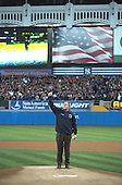 President George W. Bush gives a thumbs-up sign to a cheering crowd just before throwing the ceremonial first pitch for Game 3 of the World Series in Yankee Stadium, New York, Tuesday, October 30, 2001..Mandatory Credit: Eric Draper - White House via CNP.