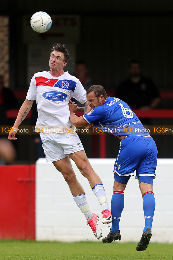 Luke Wilkinson of Stevenage and Oliver Hawkins of Dagenham during Dagenham & Redbridge vs Stevenage, Friendly Match Football at the Chigwell Construction Stadium on 29th July 2017