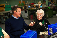 Wednesday 19 February 2014<br /> Pictured:Factory worker  Ann Griffiths with Prime Minister David Cameron <br /> Re: Prime Minister David Cameron visitingthe  St David Assemblies factory  in St. Davids, Pembrokeshire, Wales