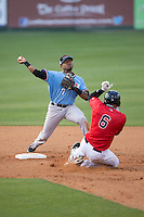 Andy Ibanez (7) of the Hickory Crawdads prepares to turn a double play as Antonio Rodriguez (6) of the Kannapolis Intimidators begins his slide into second base at Kannapolis Intimidators Stadium on April 10, 2016 in Kannapolis, North Carolina.  The Intimidators defeated the Crawdads 10-3.  (Brian Westerholt/Four Seam Images)