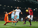Adrian of West Ham United makes a save from Anthony Martial of Manchester United during the English League Cup Quarter Final match at Old Trafford  Stadium, Manchester. Picture date: November 30th, 2016. Pic Simon Bellis/Sportimage