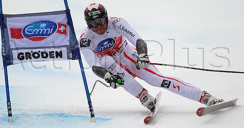 17.12.2010 Winner Michael Walchhofer of Austria skiing in Men Super-G race of Audi FIS alpine skiing World Cup in Val Gardena, Italy. Super-G race of Men Audi FIS Alpine skiing World Cup 2010-11, was held  on Saslong course in Val Gardena, Italy...
