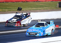 May 14, 2016; Commerce, GA, USA; NHRA funny car driver Tommy Johnson Jr (near) races alongside Tim Wilkerson during qualifying for the Southern Nationals at Atlanta Dragway. Mandatory Credit: Mark J. Rebilas-USA TODAY Sports