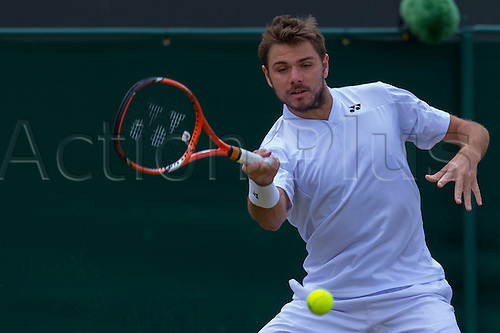 30.06.2014.  London, England.  Wimbledon Championships Day Seven Stan Wawrinka of Switzerland in action against Denis Istomin of Uzbekistan during day seven men's singles third round match at the Wimbledon Tennis Championships at The All England Lawn Tennis Club in London, United Kingdom