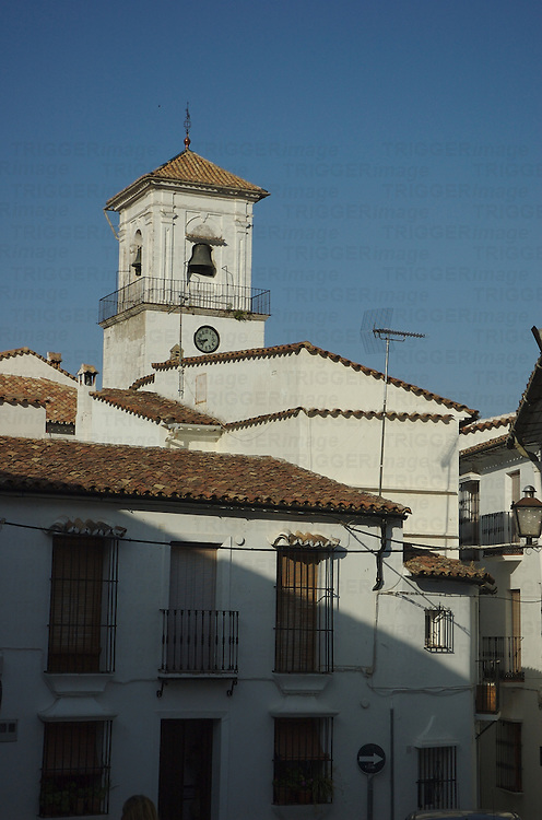 Spanish rooftops and a bell tower