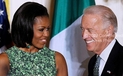 First Lady Michelle Obama and Vice President Joe Biden attend a St. Patrick's Day reception in the East Room of the White House in Washington, DC, March 17, 2011. .Credit: Olivier Douliery / Pool via CNP