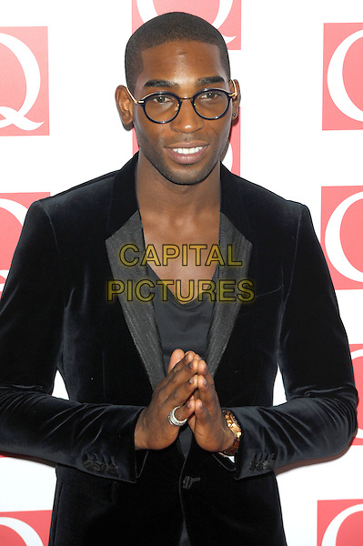 Tinie Tempah (Patrick Chukwuemeka Okogwu)<br /> attending the Q Awards, Grosvenor House Hotel, London, England. <br /> 21st October 2013<br /> half length black jacket velvet glasses hands together praying <br /> CAP/CJ<br /> &copy;Chris Joseph/Capital Pictures