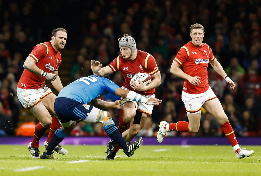 Wales' Jonathan Davies is tackled by Italy's Gonzalo Garcia<br /> <br /> Photographer Simon King/CameraSport<br /> <br /> International Rugby Union - RBS 6 Nations Championships 2016 - Wales v Italy - Saturday 19th March 2016 - Principality Stadium, Cardiff <br /> <br /> &copy; CameraSport - 43 Linden Ave. Countesthorpe. Leicester. England. LE8 5PG - Tel: +44 (0) 116 277 4147 - admin@camerasport.com - www.camerasport.com