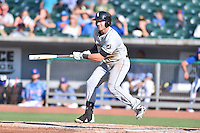 Birmingham Barons third baseman Nicky Delmonico (4) swings at a pitch during a game against the Tennessee Smokies on August 2, 2015 in Kodak, Tennessee. The Smokies defeated the Barons 5-2. (Tony Farlow/Four Seam Images)