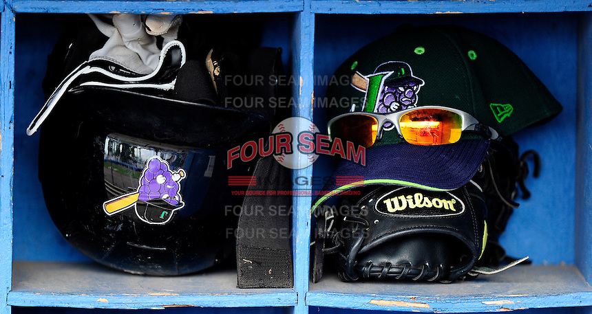 Jamestown Jammers hat, glasses, helmet and batting gloves during practice before a game against the Batavia Muckdogs at Dwyer Stadium on June 22, 2012 in Batavia, New York.  Jamestown defeated Batavia 7-5.  (Mike Janes/Four Seam Images)