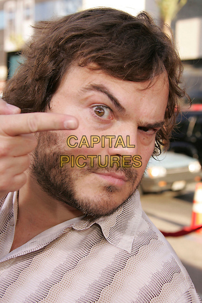 "JACK BLACK.""Nacho Libre"" World Premiere held at Grauman's Chinese Theatre, Hollywood, California, USA,.June 12th 2006..portrait headshot funny face one eyebrow raised beard pointing to  eye.Ref: ADM/RE.www.capitalpictures.com.sales@capitalpictures.com.©Russ Elliot/AdMedia/Capital Pictures."
