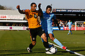 James Meredith of York tackles Jordan Patrick of Cambridge United during the Blue Square Bet Premier match between Cambridge United and York City at the Abbey Stadium, Cambridge on 19th March, 2011.© Kevin Coleman 2011