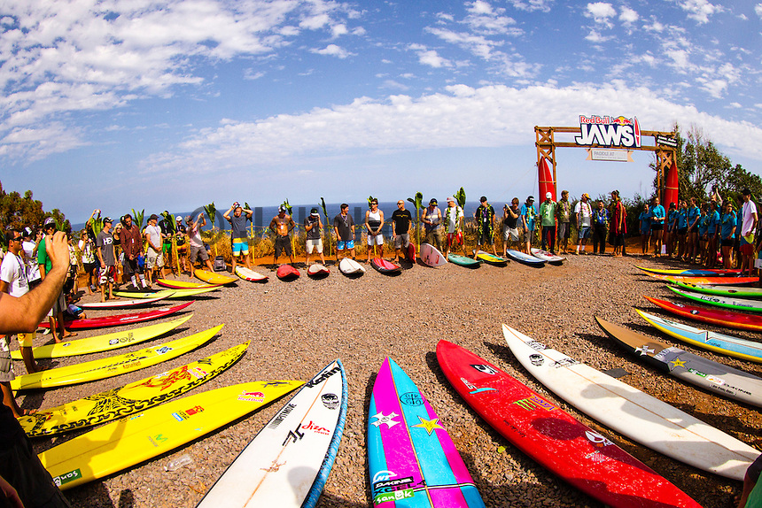 """Pe'ahi, Maui, HAWAII - (December 8, 2012) - Invitees and alternates of the RED BULL JAWS, Paddle at Pe'ahi big wave event gathered high upon the Pe'ahi Overlook in a private blessing that officially opened the three-month holding period for this one-day event. A spiritual ceremony, deeply rooted in Maui's history and Polynesian culture, took place under unusually clear and hot skies, with barely a breath of wind.  . The RED BULL JAWS, Paddle at Pe'ahi presented by Casio G'z One is a one-day big wave paddle-in surfing event that will be held on a single day between December 7, 2012 and March 15, 2013, when wave face heights reach between 30 and 50 feet, and with no assistance from motorized personal watercraft..Led by Kupuna Leslie Kuloloio and Kumu Pulama Collier, surfers listened to the ancestral story of Pe'ahi - known to Hawaiians as Ke Kai 'o Waitakulu, or """"the teary eye place"""". Each was presented with a special kihei, or cloak, in recognition of their expertise in big wave riding..  Photo: joliphotos.com"""
