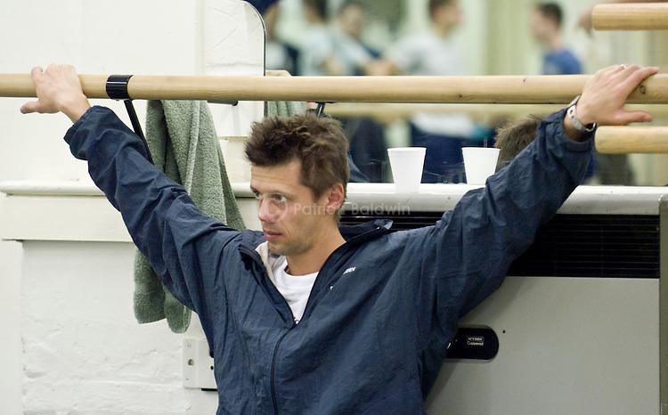 English National Ballet dancer Dmitri Gruzdyev resting during rehearsals.