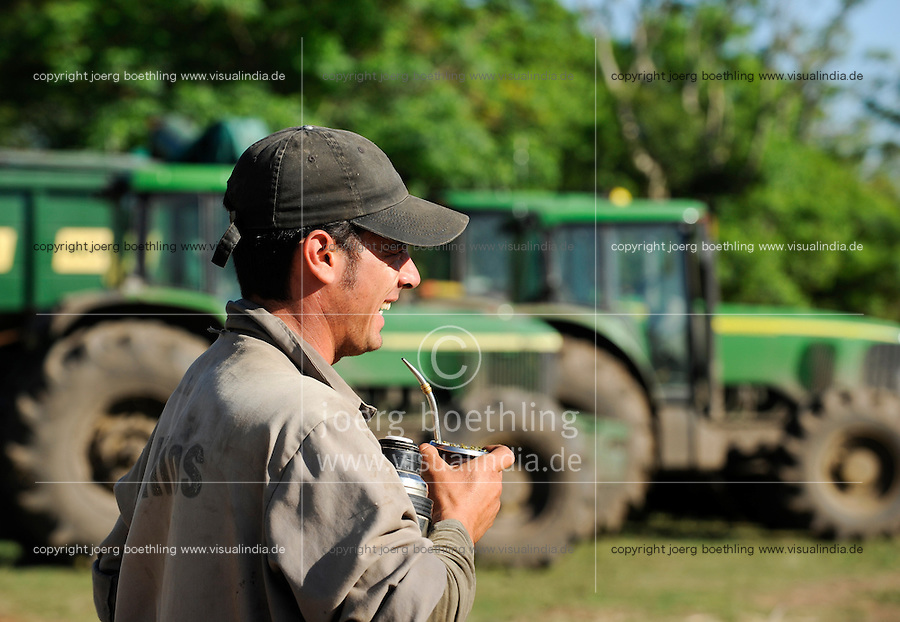 URUGUAY Bella Union, man drinks Mate tea at farm