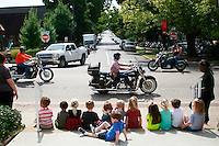 "NWA Democrat-Gazette/DAN HOLTMEYER<br /> A Central United Methodist Church preschool class watches as motorcycles thunder past on Dickson Street in Fayetteville during lunchtime Thursday, cheering as each one passes. ""They are loving it,"" Wanda Carr, their teacher, at right, said with a laugh. Though Dickson is Bikes, Blues & BBQ's heart, other venues are open at Baum Stadium, the Washington County Fairgrounds and in Springdale."