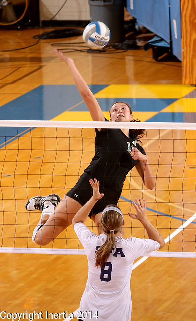BROOKINGS, SD - SEPTEMBER 5:  Wagner Larson #11 from South Dakota State winds up to get a kill past Kelsi Bartlett #8 from Stephen F. Austin during their match Friday afternoon at Frost Arena in Brookings. (Photo/Dave Eggen/Inertia)