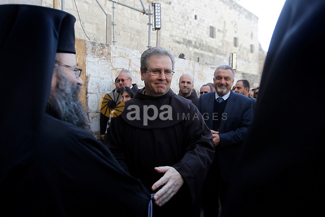 Custodian of the Holy Land Father Francesco Patton arrives to the church of Nativity to ceremonially launch the beginning of the Christmas season, in the West Bank city of Bethlehem November 26, 2016. Photo by Wisam Hashlamoun