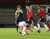 Thomas Reilly closes down Sargis Shahinyan in the Scotland v Armenia UEFA European Under-19 Championship Qualifying Round match at New Douglas Park, Hamilton on 9.10.12.
