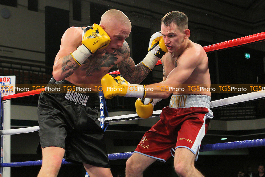Lee Markham (black shorts) defeats Danny Brown in a Light-Middleweight boxing contest at York Hall, Bethnal Green, promoted by Frank Warren - 14/12/11 - MANDATORY CREDIT: Gavin Ellis/TGSPHOTO - Self billing applies where appropriate - 0845 094 6026 - contact@tgsphoto.co.uk - NO UNPAID USE.