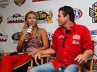 Sep 3, 2016; Clermont, IN, USA; NHRA top fuel driver Leah Pritchett (left) with Papa Johns pizza founder John Schnatter during qualifying for the US Nationals at Lucas Oil Raceway. Mandatory Credit: Mark J. Rebilas-USA TODAY Sports
